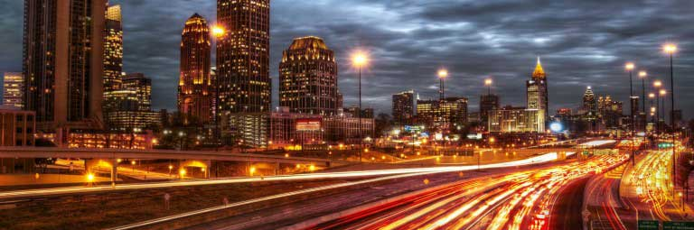 Atlanta city night with lights from buildings, streetlights and cars.