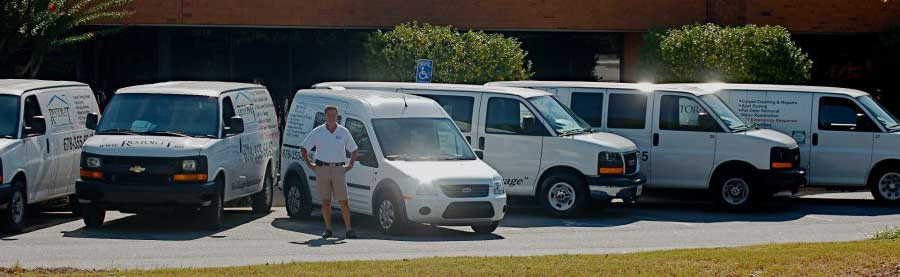 Bob Rowley, the owner of Restor-It, with Restor-It vans.